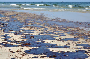 Oil spill on the beach