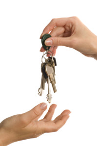 Landlord hands keys to tenant